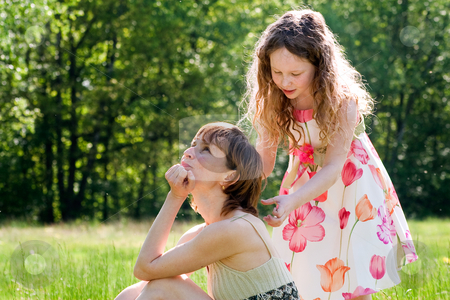 Playing the hair stylist stock photo, Mother and daughter have a happy time together by Frenk and Danielle Kaufmann