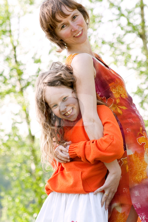 Mother and daugther with humor stock photo, Mother and daughter have a happy time together by Frenk and Danielle Kaufmann