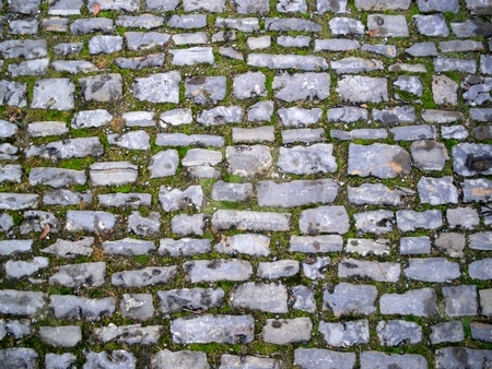 Cobblestone stock photo, Old gray medieval weathered cobblestone way in Germany. by Henrik Lehnerer