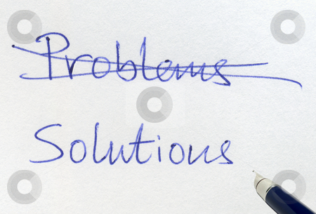 Crossing out problems and writing solutions. stock photo, Crossing out problems and writing solutions. by Stephen Rees