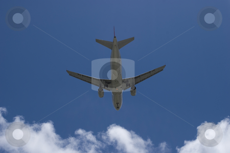 Airplane Bottom View stock photo, Bottom view of a flying airplane by Robert Cabrera