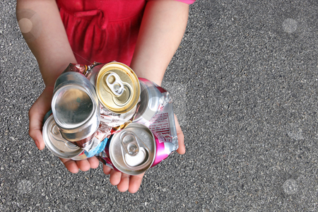 Child Recycling Aluminum Cans stock photo, Recycling Aluminum Cans in a Child's Hands by Katrina Brown