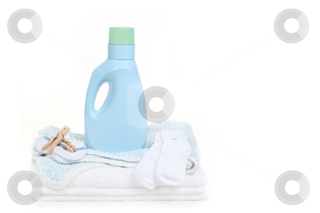 Baby Blanket With Socks Clothespins and Detergent stock photo, Baby Blanket With Socks Clothespins and Detergent on White Background by Katrina Brown