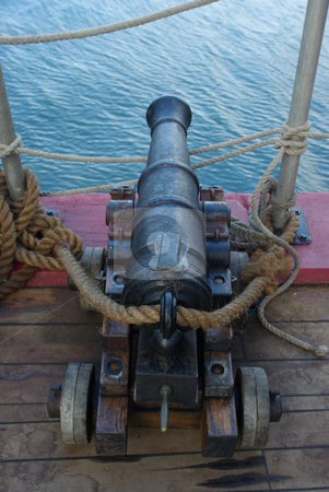 Old Ship Cannon stock photo, An old 18th century naval cannon on the deck of a sailing ship by Lynn Bendickson