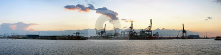 Harbor view stock photo, Panoramic image of a commercial harbor area at dusk on a very quiet day by Corepics VOF