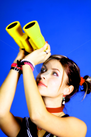 Young woman stock photo, Young woman with a spyglass by Yvonne Bogdanski