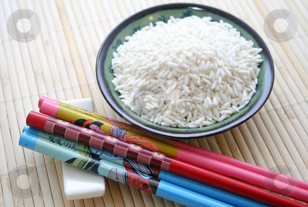 Chopsticks and rice stock photo, Chopsticks and rice by Yvonne Bogdanski
