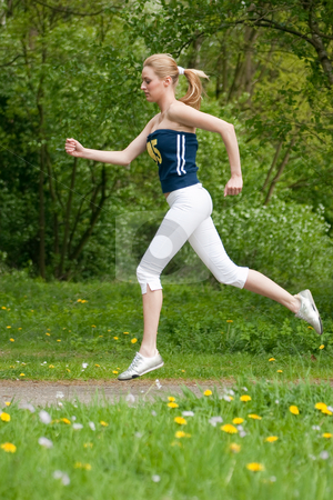Let's Sport stock photo, Young girl is  jogging in the nature by Frenk and Danielle Kaufmann