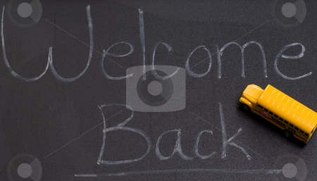 Back To School stock photo, A black board with the words welcome back, and also a small toy school bus by Richard Nelson