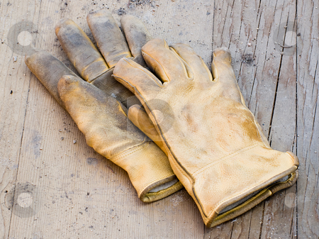 Work Gloves stock photo, A pair of work gloves lying on planks of wood by Richard Nelson
