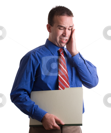 Too Much Work stock photo, A businessman holding a folder and suffering from a lot of stress, isolated against a white background by Richard Nelson