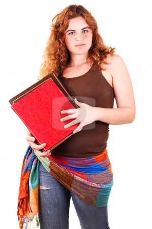 Schoolgirl wit books. stock photo, A pretty bright red haired girl with some folders in her hand and an scarf around her waist in old torn jeans. by Horst Petzold