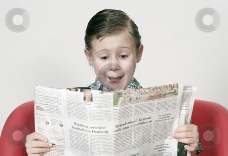 Boy with a newspaper stock photo, Studio by Yvonne Bogdanski