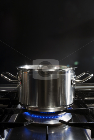 Cooking on Gaz stock photo, A stainless steel pan on a stove by Corepics VOF