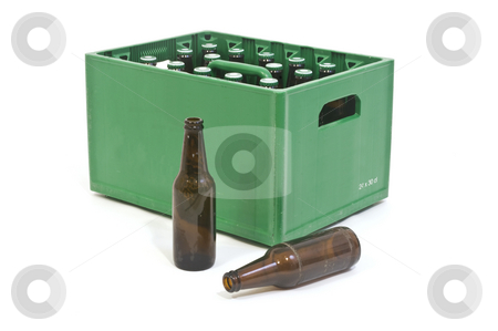 Green crate stock photo, Beer crate with two empty bottles in front by Corepics VOF