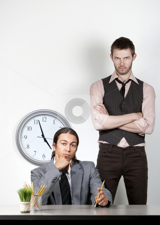 Bored man and angry coworker stock photo, Bored man at work with an angry coworker behind him by Scott Griessel