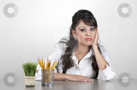 Bored woman at work stock photo, Bored woman at her desk making a funny expression by Scott Griessel