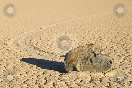 The Phenomenon of the Moving Rocks stock photo, The phenomenon of the moving rocks at the race track playa of Death Valley National Park by Corepics VOF