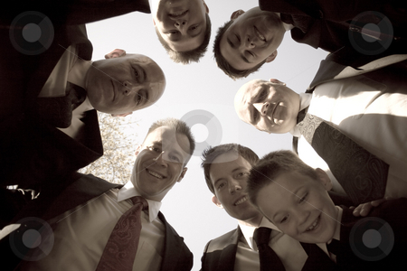 Groomsmen Huddle stock photo, A groom and his groomsmen posing together in a huddle formation. by Todd Arena