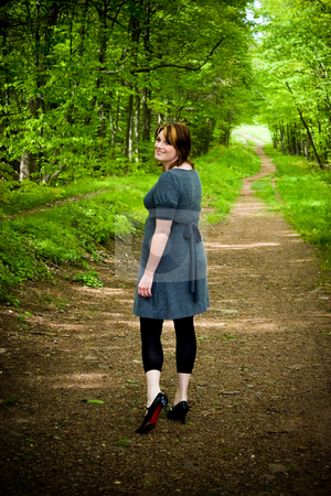 Path Through the Woods stock photo, A young woman walking through a wooded path. by Todd Arena