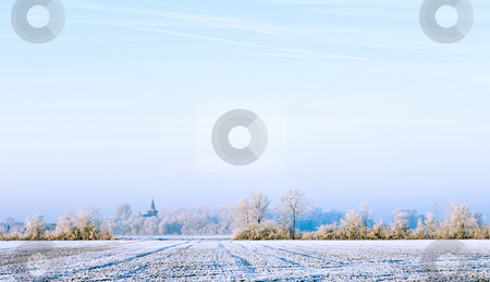 Winter landscape stock photo, The soft, sun-lit polders and view on the church of Ellewoutsdijk, Zeeland, The Netherlands on a cold, hoarfrosted morning by Corepics VOF