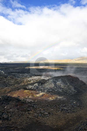 Volcanic rainbow stock photo, The Kroflustod lava fields of the 1984 eruption of the Krafla Volcano. The solidified magma and lava is still hot, and provide a spectacular barren  view by Corepics VOF
