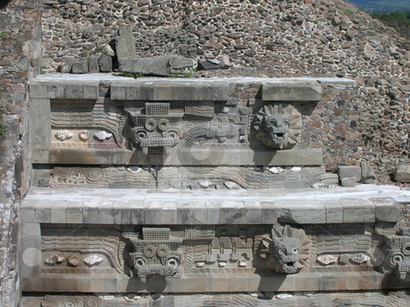 Teotihuacan stock photo, Feathered snakes on the side wall of a pyramid in Mexico by Jose .