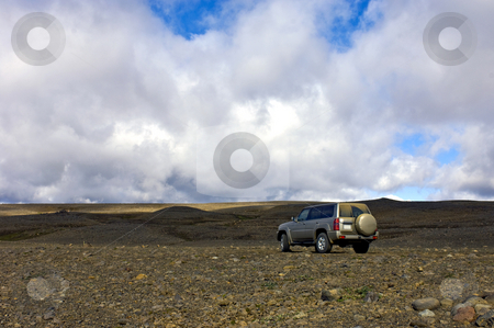 Middle of nowhere stock photo, A big four by four all terrain car in the vastness of the Icelandic tundra by Corepics VOF
