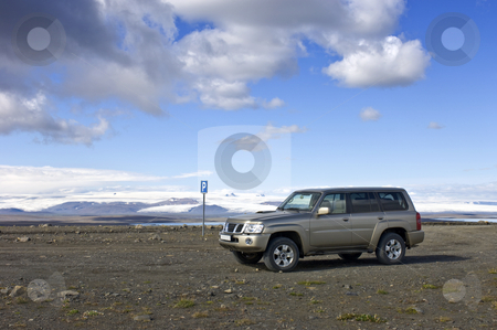 A place to park stock photo, A parking lot in the middle of nowhere, with a view on the Icelandic Tundra and the huge Vatnajokull glacier along the Sprengisandur Highland Route by Corepics VOF