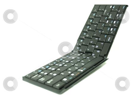Folding Keyboard 02 stock photo, Folding portable keybord over white background by Jose .