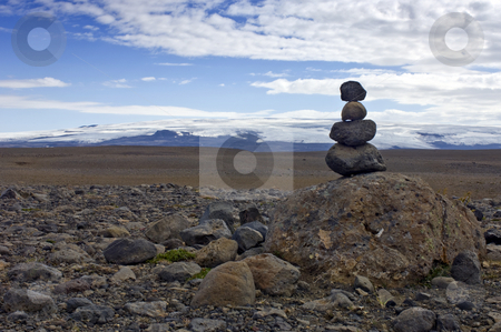 Stone man stock photo, A Varda - or stone man - symbolising a safe onward journey, is often encountered in the rough Icelandic interior. To some it's just a stack of rocks, to others the perfect balance amongst the volcanic stones represents Zen by Corepics VOF