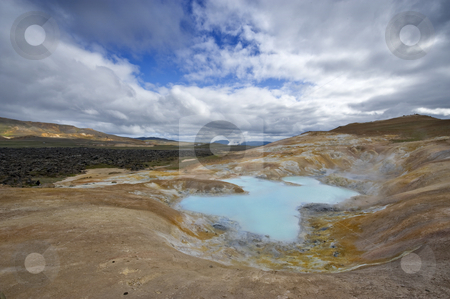 Krafla Volcanic System stock photo, A turquoise lake in a caldera of the Krafla volcanic system, with the lava fields and geothermal activity and its mudpools in the Myvatn region, Iceland by Corepics VOF