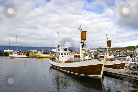Arctic Whale Watching Harbor stock photo, The arctic harbor of Husavik along the Skjalfandi bay, Iceland, with a colorful array of fishing ships, from where tourists are taken on whale watching trips by Corepics VOF