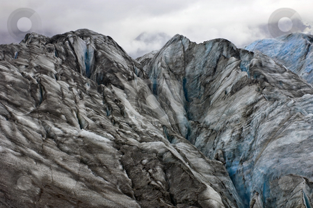 Deadly Glacier stock photo, The crevases and icy textured surface of the Svinafellsjokull in Iceland by Corepics VOF