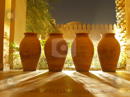 4 clay vases stock photo, Four clay vases projecting a shadow lit from the back by Jose .