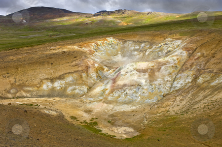 Gothermic Mud Pools stock photo, The fumaholes and mud pools in the Krafla volcanic system, with rhyolite mountains, silica and sulfur depositions, creating a spectacular colorful view by Corepics VOF