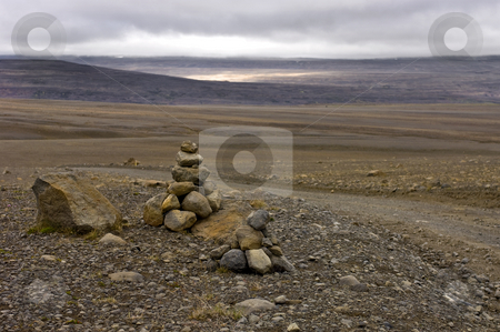 Icelandic Tundra stock photo, The barren emptiness of the Icelandic Highlands, with a varda, symbolising the custom for a safe onward journey by Corepics VOF
