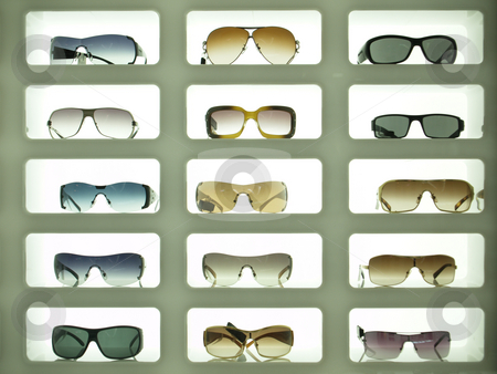 Sunglasses 02 stock photo, Sunglases displayed in three columns and lit from the background by Jose .