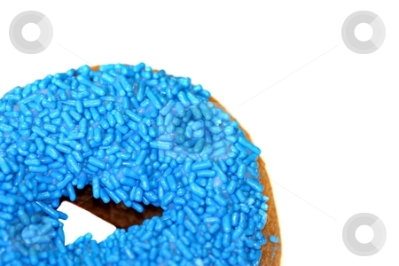 Blue Doughnut stock photo, Blue doughnut in bottom left corner on white background by Henrik Lehnerer