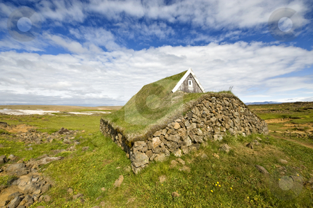 Traditional Icelandic Cabin stock photo, The stone walls, and grass covered roof for insulation purposes of an old, traditionally build cabin in Hveravallir, Iceland by Corepics VOF