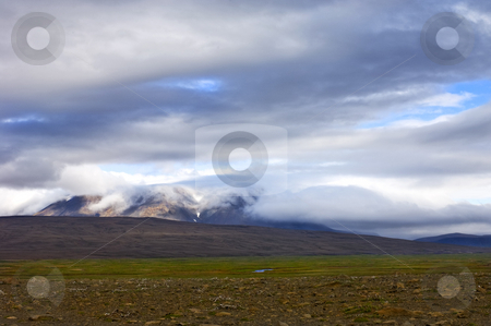 Tundra stock photo, A layered Icelandic tundra landscape, with clouds rolling in from the glacier in the background by Corepics VOF