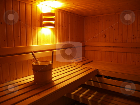 Sauna 01 stock photo, Sauna interior with bucket beneath a lamp by Jose .