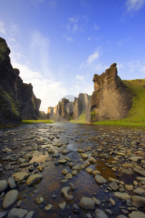 Hunkarbakkar Canyon stock photo, An ancient Canyon in Hunkarbakkar, Iceland, where the different layers of volcanic branch pipes have created hard structures, which still stand erect, when over time, the softer ashes and eruption debris has been eroded away, forming the erratic banks of the canyon by Corepics VOF