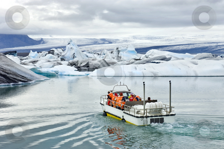 Jokulsarlon Amphibious tour stock photo, An amphibuous vehicle taking tourists for a cruise around the icebergs in the Jokulsarlon glacier lake, where huge chunks of ice from the Vatnajokull glacier float out to the Atlantic ocean by Corepics VOF