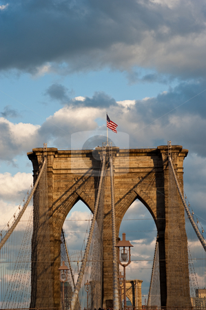 Brooklyn bridge, new york city stock photo, Detail of western bridge standard with american flag on top.  new york city by Ron Greer