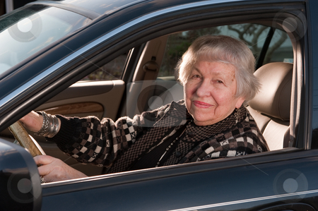 86 year old woman at her home, drivingn her car stock photo, 86 year old woman driving her car by Ron Greer