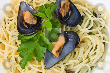 Spaghetti with mussels 2 stock photo, Spaghetti with mussels cooked with lightly garlic, onion and parsley It's a typical italian food by ANTONIO SCARPI