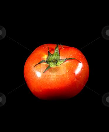 Tomato on black stock photo, Fresh vivid ripe tomato over black background by Francesco Perre