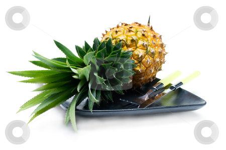 Pineapple stock photo, Pineapple on a black plate with knife and fork isolated on white background by Francesco Perre