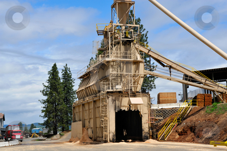 Lumber Mill stock photo, Saw dust loading terminal. Loads trucks with milling by-products that is then recycled into other products made of wood by Lynn Bendickson